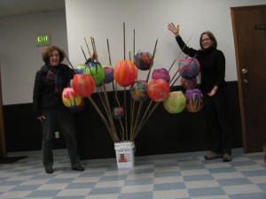 Diane and Monica showing off some finished lanterns from the Lantern Making Workshop.